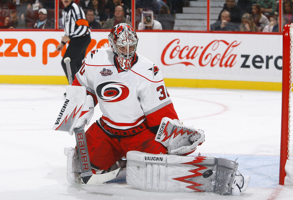 OTTAWA ON - OCTOBER 14:  Cam Ward making a save on one of at least 30 shots he faced on the night. (Photo by Phillip MacCallum/Getty Images)