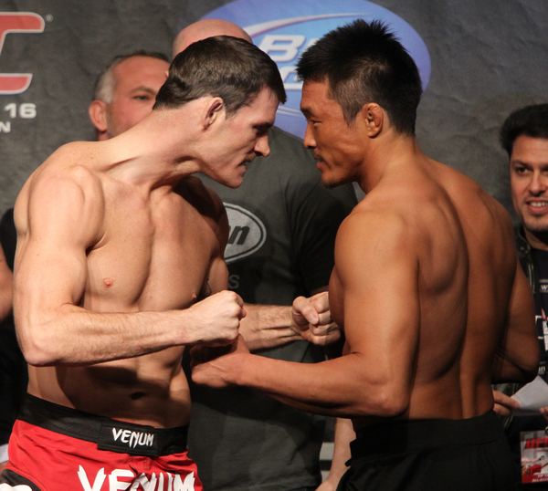 LONDON - OCTOBER 15:  (L-R) Middleweight opponents Michael Bisping and Yoshihiro Akiyama face off at the UFC 120 weigh-in at Earl's Court Arena on October 15 2010 in London England.  (Photo by Josh Hedges/Zuffa LLC/Zuffa LLC via Getty Images)
