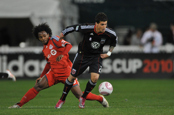 WASHINGTON DC - OCTOBER 23:  Santino Quaranta #25 of D.C. United takes the ball away from Julian de Guzman #6 of Toronto FC at RFK Stadium on October 23 2010 in Washington DC. Toronto defeated DC 3-2. (Photo by Larry French/Getty Images)