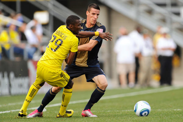 COLUMBUS OH - OCTOBER 24:  Sebastien Le Toux #9 of the Philadelphia Union battles for control of the ball with Shaun Francis #29 of the Columbus Crew on October 24 2010 at Crew Stadium in Columbus Ohio.  (Photo by Jamie Sabau/Getty Images)