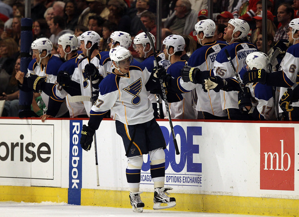 """David Perron #57 of the St. Louis Blues celebrates a goal with teammates.  He's also got to be psyched that """"The 'Cock"""" gave him over 5 minutes of PP last night."""