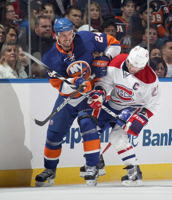 UNIONDALE NY - OCTOBER 29: Brian Gionta #21 of the Montreal Canadiens holds up Radek Martinek #24 of the New York Islanders at the Nassau Coliseum on October 29 2010 in Uniondale New York.  (Photo by Bruce Bennett/Getty Images)