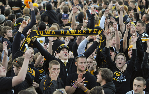 IOWA CITY IA - OCTOBER 30: University of Iowa Hawkeyes fans celebrate their win over the Michigan State Spartans at Kinnick Stadium on October 30 2010 in Iowa City Iowa. Iowa won 37-6 over Michigan State. (Photo by David Purdy/Getty Images)