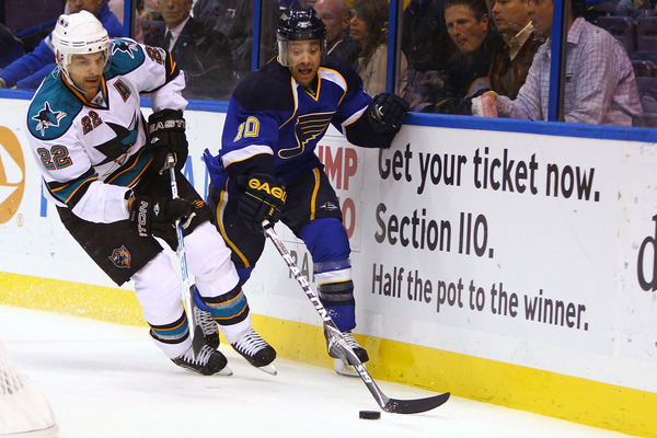 ST. LOUIS - NOVEMBER 4: Andy McDonald #10 of the St. Louis Blues looks to keep the puck away from Dan Boyle #22 of the San Jose Sharks at the Scottrade Center on November 4 2010 in St. Louis Missouri.  (Photo by Dilip Vishwanat/Getty Images)