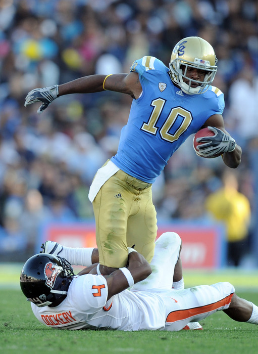 PASADENA CA - NOVEMBER 06:  Akeem Ayers #10 of the UCLA Bruins is tackled by James Dockery #4 of the Oregon State Beavers during the first quarter at the Rose Bowl on November 6 2010 in Pasadena California.  (Photo by Harry How/Getty Images)