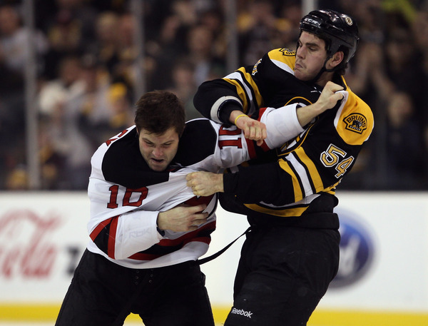 BOSTON - NOVEMBER 15:  Adam McQuaid #54 of the Boston Bruins and Rod Pelley #10 of the New Jersey Devils fight on November 15 2010 at the TD Garden in Boston Massachusetts.  (Photo by Elsa/Getty Images)
