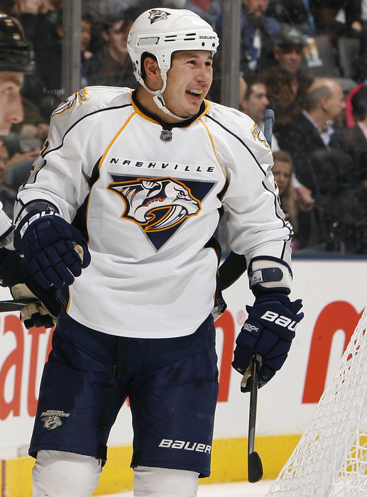 TORONTO - NOVEMBER 16: Jordin Tootoo #22 of the Nashville Predators celebrates his goal during game action against the Toronto Maple Leafs at the Air Canada Centre November 16 2010 in Toronto Ontario Canada. (Photo by Abelimages/Getty Images)