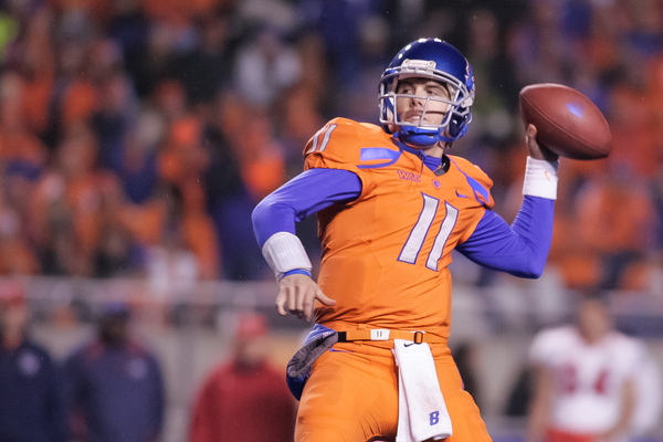 BOISE ID - NOVEMBER 19:  Kellen Moore #11 of the Boise State Broncos passes against the Fresno State Bulldogs at Bronco Stadium on November 19 2010 in Boise Idaho.  (Photo by Otto Kitsinger III/Getty Images)