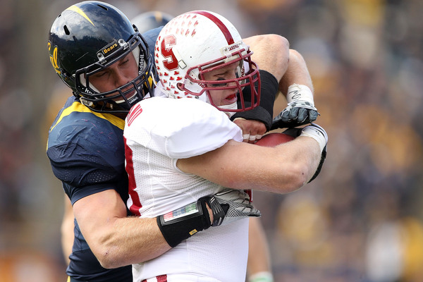 BERKELEY CA - NOVEMBER 20:  Konrad Reuland #88 of the Stanford Cardinal is tackled by Mike Mohamed #18 of the California Golden Bears at California Memorial Stadium on November 20 2010 in Berkeley California.  (Photo by Ezra Shaw/Getty Images)