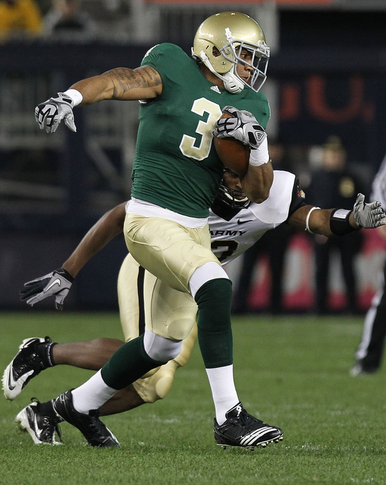 NEW YORK - NOVEMBER 20: Michael Floyd #3 of the Notre Dame Fighting Irish rushes against the Army Black Knights at Yankee Stadium on November 20 2010 in the Bronx borough of New York City.  (Photo by Nick Laham/Getty Images)