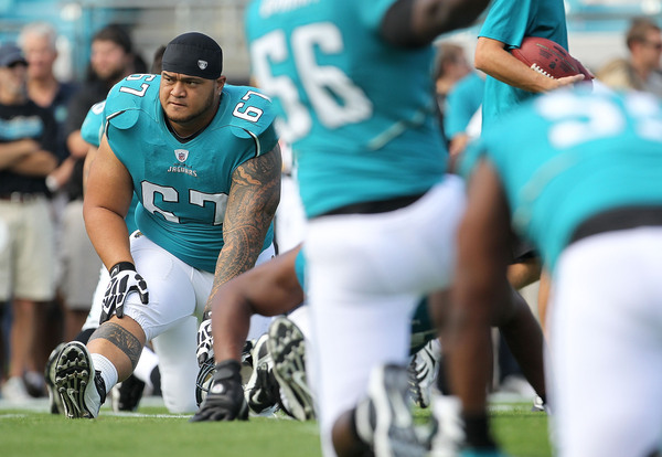 JACKSONVILLE FL - NOVEMBER 21:  Vince Manuwai #67 of the Jacksonville Jaguars stretches  during a game agaisnt the Cleveland Browns at EverBank Field on November 21 2010 in Jacksonville Florida.  (Photo by Mike Ehrmann/Getty Images)