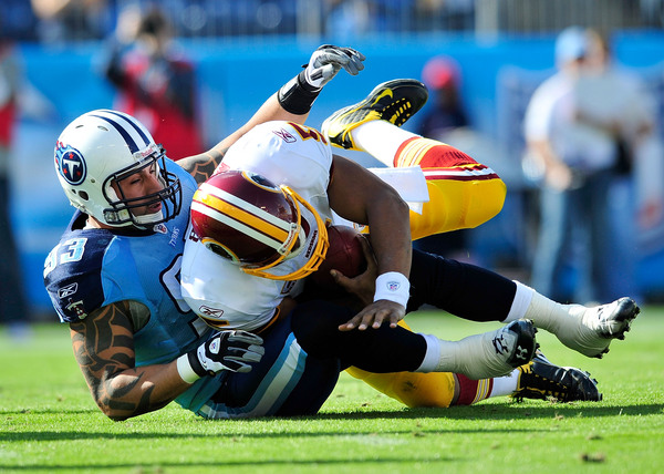 NASHVILLE TN - NOVEMBER 21:  Jason Babin #93 of the Tennessee Titans sacks quarterback Donovan McNabb #5 of the Washington Redskins during the first half at LP Field on November 21 2010 in Nashville Tennessee.  (Photo by Grant Halverson/Getty Images)