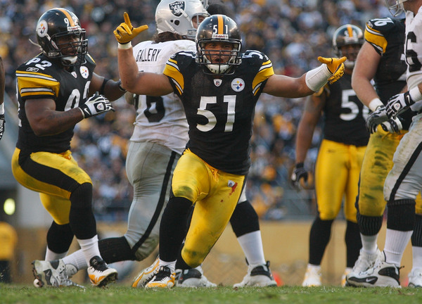 PITTSBURGH - NOVEMBER 21:  James Farrior #51 of the Pittsburgh Steelers celebrates after a sack against the Oakland Raiders during the game on November 21 2010 at Heinz Field in Pittsburgh Pennsylvania.  (Photo by Jared Wickerham/Getty Images)
