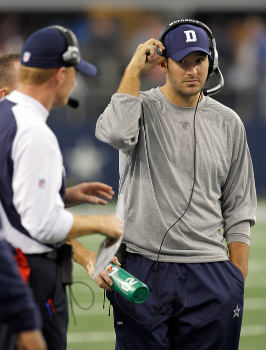 Will Tony Romo take off the headphones and play this year? Jimmy Johnson would advise against it.
