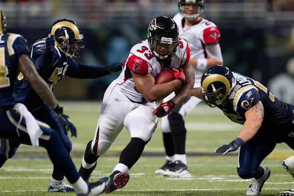 ST. LOUIS - NOVEMBER 21: Michael Turner #33 of the Atlanta Falcons rushes against the St. Louis Rams at the Edward Jones Dome on November 21 2010 in St. Louis Missouri.  The Falcons beat the Rams 34-17.  (Photo by Dilip Vishwanat/Getty Images)