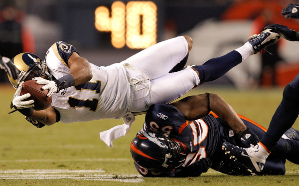 Wide receiver Brandon Gibson #11 of the St. Louis Rams dives over linebacker D.J. Williams #55 of the Denver Broncos. Picking the Rams for the victory of the week is hardly a stretch.