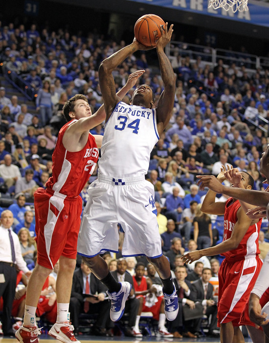 LEXINGTON KY - NOVEMBER 30: DeAndre Liggins #34 of the Kentucky Wildcats shoots the ball during the game against the Boston University Terriers on November 30 2010 in Lexington Kentucky.  (Photo by Andy Lyons/Getty Images)
