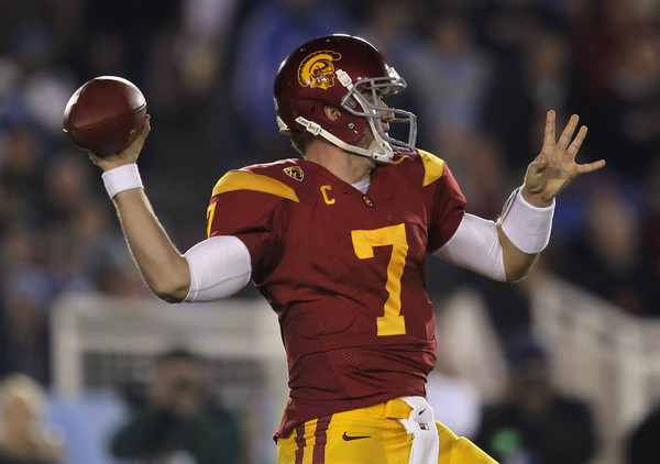PASADENA CA - DECEMBER 04:  Quarterback Matt Barkley #7 of the USC Trojans drops back to pass against the UCLA Bruins during the first half at the Rose Bowl on December 4 2010 in Pasadena California.  (Photo by Jeff Gross/Getty Images)