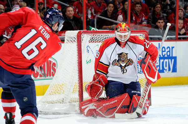 Tomas Vokoun (then of the Florida Panthers, now of the Washington Capitals) makes a save against Eric Fehr (then of the Washington Capitals, now of the Winnipeg Jets) at the Verizon Center on December 9 2010 in Washington DC.