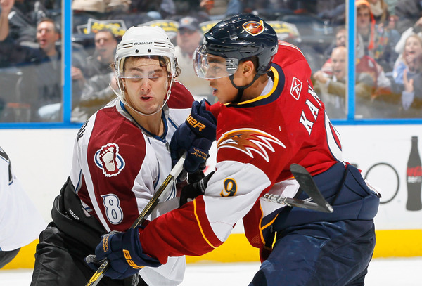ATLANTA GA - DECEMBER 10:  Evander Kane #9 of the Atlanta Thrashers squares off against Kevin Shattenkirk #8 of the Colorado Avalanche at Philips Arena on December 10 2010 in Atlanta Georgia.  (Photo by Kevin C. Cox/Getty Images)