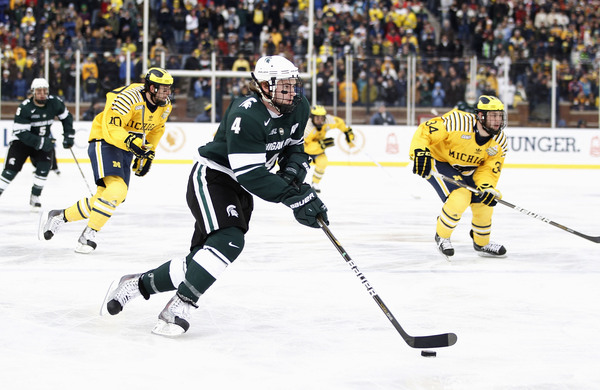 ANN ARBOR MI - DECEMBER 11:  Trevor Nill #4 of the Michigan State Spartans heads up ice while playing the Michigan Wolverines at Michigan Stadium on December 11 2010 in Ann Arbor Michigan.  (Photo by Gregory Shamus/Getty Images)