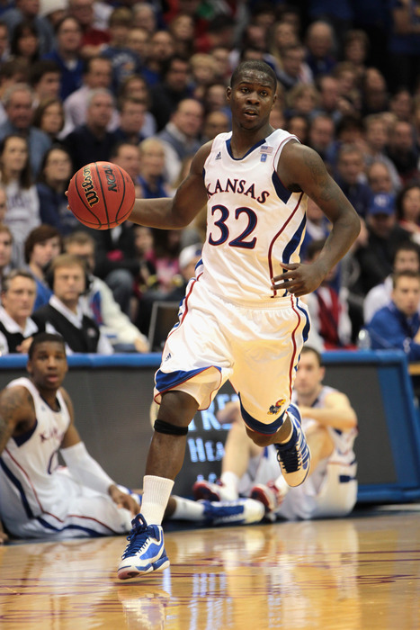 LAWRENCE KS - DECEMBER 18:  Josh Selby #32 of the Kansas Jayhawks controls the ball during the game against the USC Trojans on December 18 2010 at Allen Fieldhouse in Lawrence Kansas.  (Photo by Jamie Squire/Getty Images)