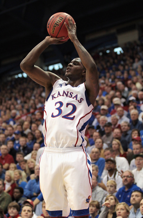 LAWRENCE KS - DECEMBER 18:  Josh Selby #32 of the Kansas Jayhawks shoots during the game against the USC Trojans on December 18 2010 at Allen Fieldhouse in Lawrence Kansas.  (Photo by Jamie Squire/Getty Images)