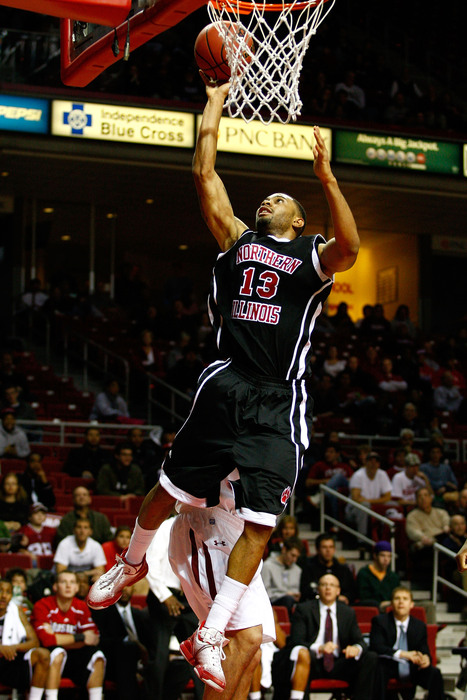 PHILADELPHIA PA - DECEMBER 18:  Xavier Silas #13 of the Northern Illinois Huskies drives for a shot attempt against the Temple Owls at the Liacouras Center on December 18 2010 in Philadelphia Pennsylvania.  (Photo by Chris Chambers/Getty Images)