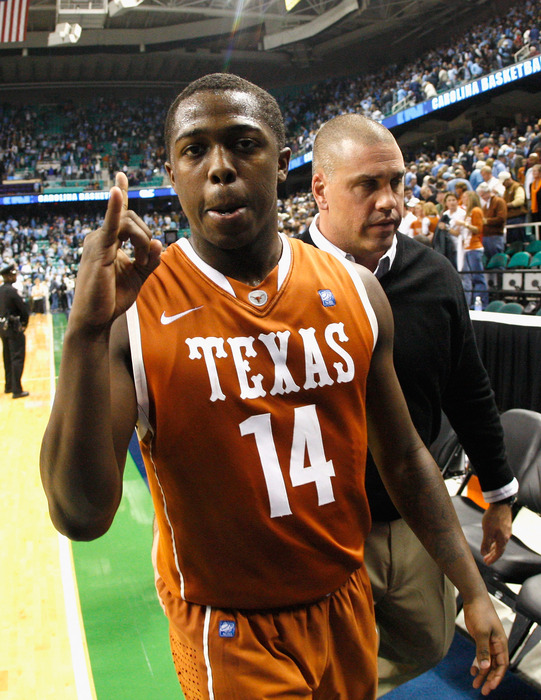 GREENSBORO NC - DECEMBER 18:  J'Covan Brown #14 of the Texas Longhorns reacts after their 78-76 win over the North Carolina Tar Heels Greensboro Coliseum on December 18 2010 in Greensboro North Carolina.  (Photo by Kevin C. Cox/Getty Images)