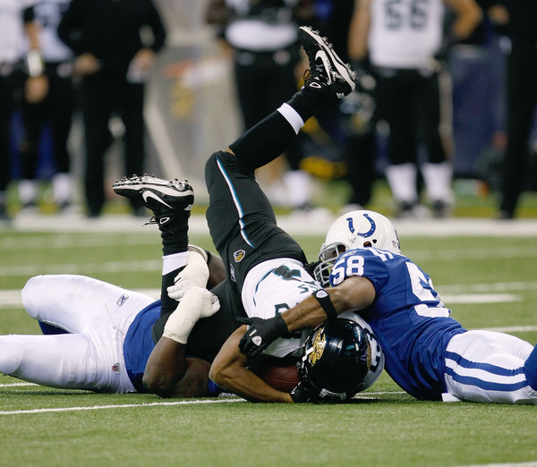 INDIANAPOLIS IN - DECEMBER 19: Maurice Jones-Drew #32 of the Jacksonville Jaguars is upended by Gary Brackett #58 of the Indianapolis Colts at Lucas Oil Stadium on December 19 2010 in Indianapolis Indiana.  (Photo by Scott Boehm/Getty Images)