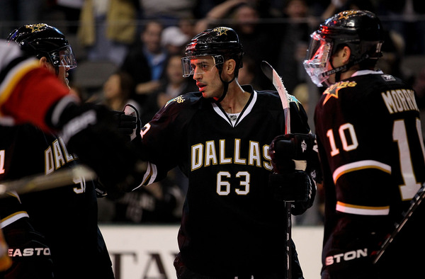 DALLAS TX - DECEMBER 23:   Center Mike Ribeiro #63 of the Dallas Stars celebrates his power play goal against the Calgary Flames at American Airlines Center on December 23 2010 in Dallas Texas.  (Photo by Ronald Martinez/Getty Images)