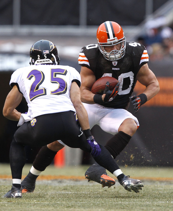 CLEVELAND - DECEMBER 26:  Tailback Peyton Hillis #40 of the Cleveland Browns runs the ball by cornerback Chris Carr #25 of the Baltimore Ravens at Cleveland Browns Stadium on December 26 2010 in Cleveland Ohio.  (Photo by Matt Sullivan/Getty Images)