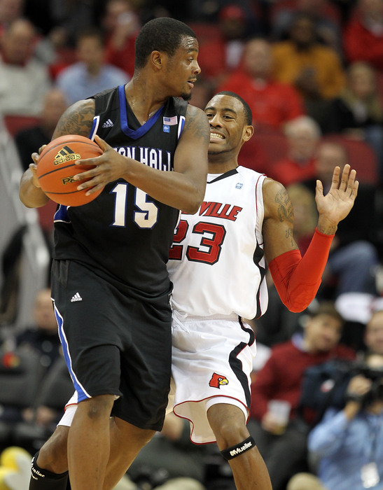 Terrence Jennings of the Louisville Cardinals puts defensive pressure on Herb Pope of the Seton Hall Pirates during the Big East Conference game at the KFC Yum! Center on January 5 2011 in Louisville Kentucky.  (Photo by Andy Lyons/Getty Images)