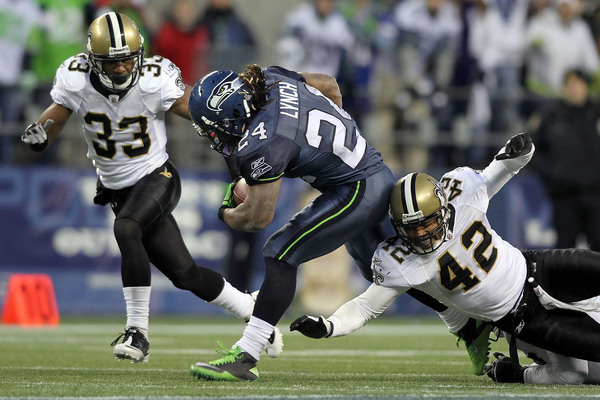 After Marshawn Lynch's Tecmo Bowl-esque run in this year's playoffs, it's easy to see which side of the ball the Saints will be focusing their attention on.  (Photo by Jonathan Ferrey/Getty Images)