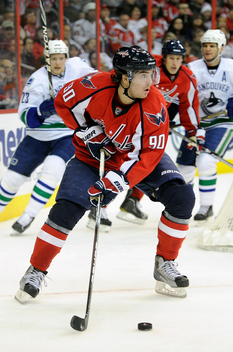 WASHINGTON - JANUARY 14:  Birthday boy Marcus Johansson #90 of the Washington Capitals handles the puck against the Vancouver Canucks at the Verizon Center on January 14 2011 in Washington DC.  (Photo by Greg Fiume/Getty Images)