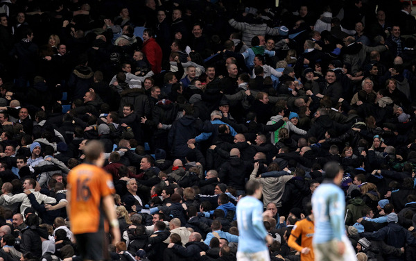 Manchester City fans turn their back on the pitch following a goal a celebration copied from Lech Poznan fans during the Barclays Premier League match between Manchester City and Wolverhampton Wanderers at the City of Manchester Stadium