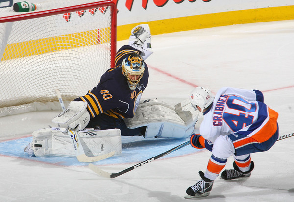 BUFFALO NY - JANUARY 21: Patrick Lalime #40 of the Buffalo Sabres makes a pad save on Michael Grabner #40 of the New York Islanders at HSBC Arena on January 21 2011 in Buffalo New York.  (Photo by Rick Stewart/Getty Images)