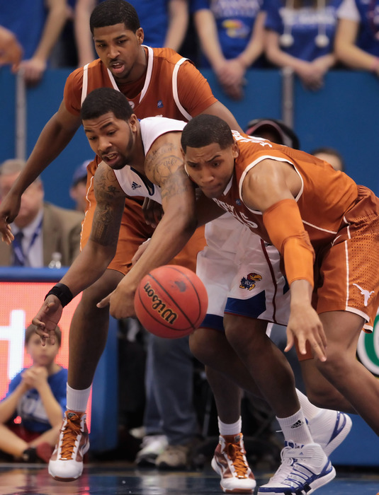LAWRENCE KS - JANUARY 22:  Markieff Morris #21 of the Kansas Jayhawks battles Gary Johnson #1  of the Texas Longhorns during the game on January 22 2011 at Allen Fieldhouse in Lawrence Kansas.  (Photo by Jamie Squire/Getty Images)