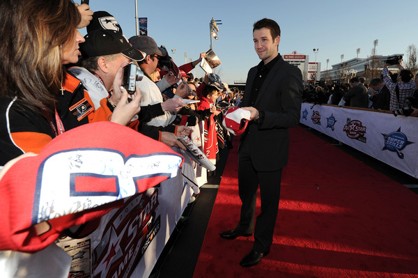 RALEIGH NC - JANUARY 29:  Cam Ward #30 of the Carolina Hurricanes and Team Staal arrives at the NHL All-Star red carpet part of 2011 NHL All-Star Weekend on January 29 2011 in Raleigh North Carolina.  (Photo by Harry How/Getty Images)