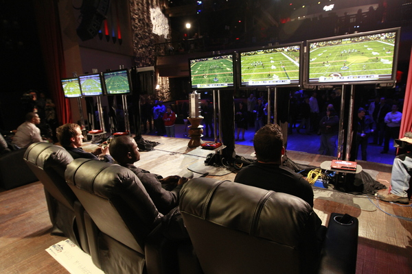 GRAPEVINE TX - FEBRUARY 03: Chase Daniel Reggie Bush and Drew Brees of the New Orleans Saints compete in the EA Sports Madden Bowl XVII on February 3 2011 in Grapevine Texas.  (Photo by Tom Pennington/Getty Images for EA Sports)