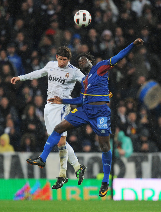 Sergio Ramos (L)  of Real Madrid goes for a high ball against Felipe Caicedo of Levante during the La Liga match between Real Madrid and Levante at Estadio Santiago Bernabeu in Madrid Spain. (Photo by Denis Doyle/Getty Images)