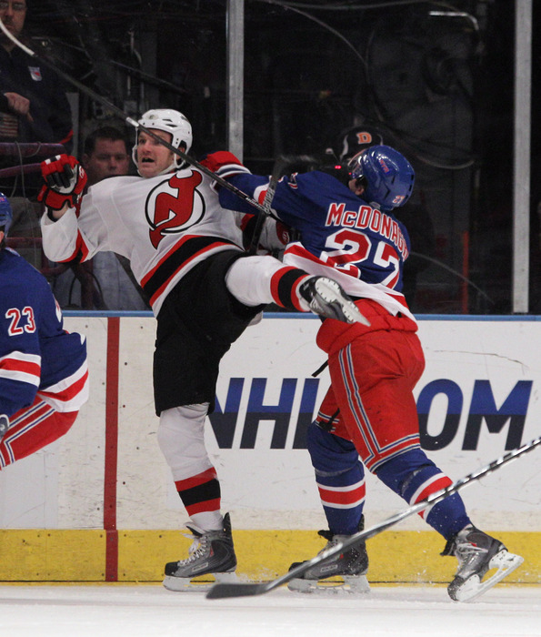 NEW YORK, NY - APRIL 09: Ryan McDonagh #27 of the New York Rangers hits David Clarkson #23 of the New Jersey Devils at Madison Square Garden on April 9, 2011 in New York City. The Rangers defeated the Devils 5-2. (Photo by Bruce Bennett/Getty Images)