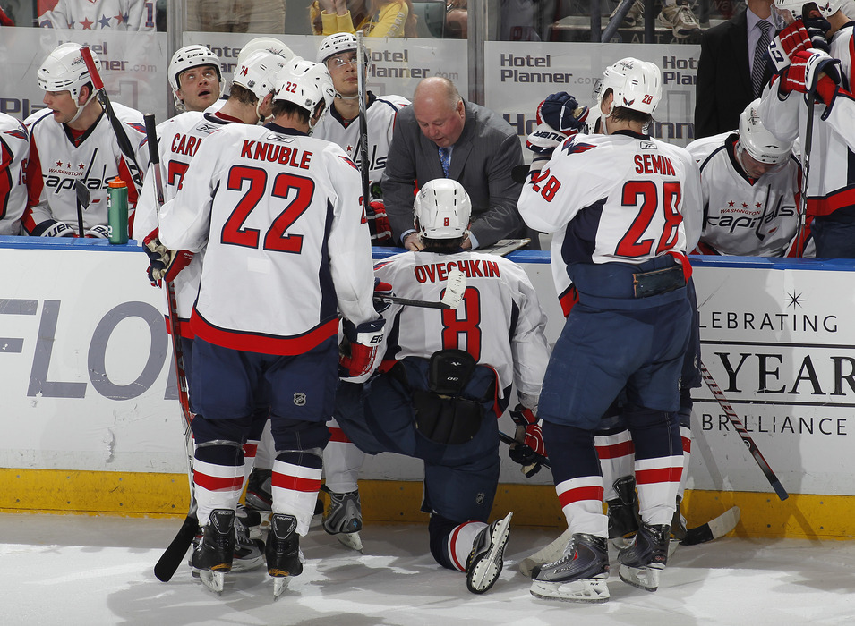 Head coach Bruce Boudreau of the Washington Capitals talks to the team during a time out in the last minute of the game against the Florida Panthers on April 9, 2011 at the BankAtlantic Center in Sunrise, Florida.