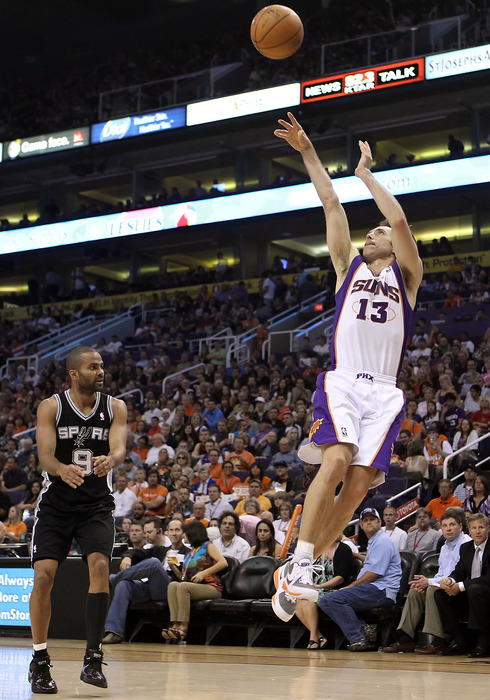 PHOENIX, AZ - APRIL 13:  Steve Nash #13 of the Phoenix Suns puts up a shot against the San Antonio Spurs during the NBA game at US Airways Center on April 13, 2011 in Phoenix, Arizona.  (Photo by Christian Petersen/Getty Images)