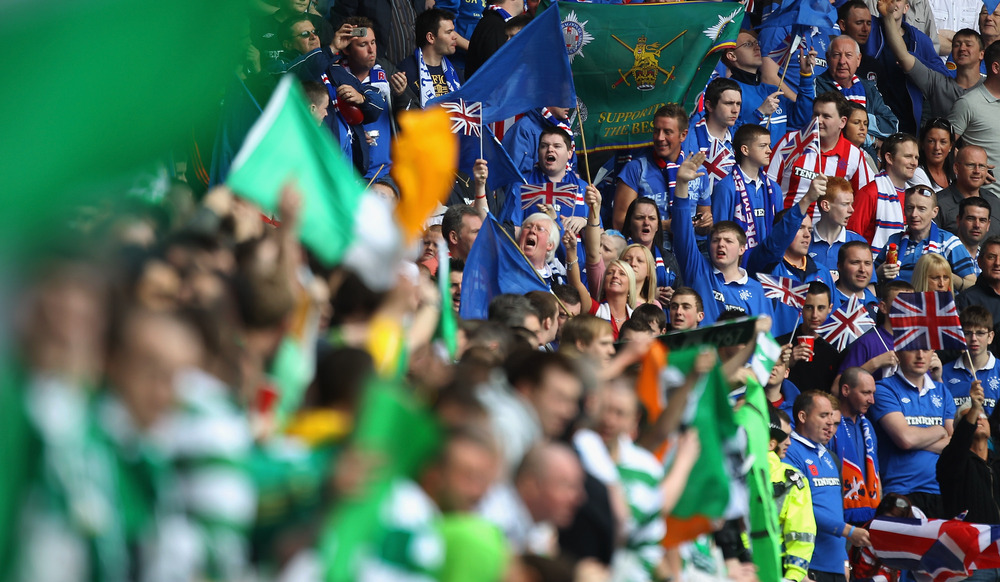 GLASGOW, SCOTLAND - APRIL 24:  Rangers and Celtic supporters chant before the Clydesdale Bank Premier League match between Rangers and Celtic at Ibrox Stadium on April 24, 2011 in Glasgow, Scotland.  (Photo by Jeff J Mitchell/Getty Images)