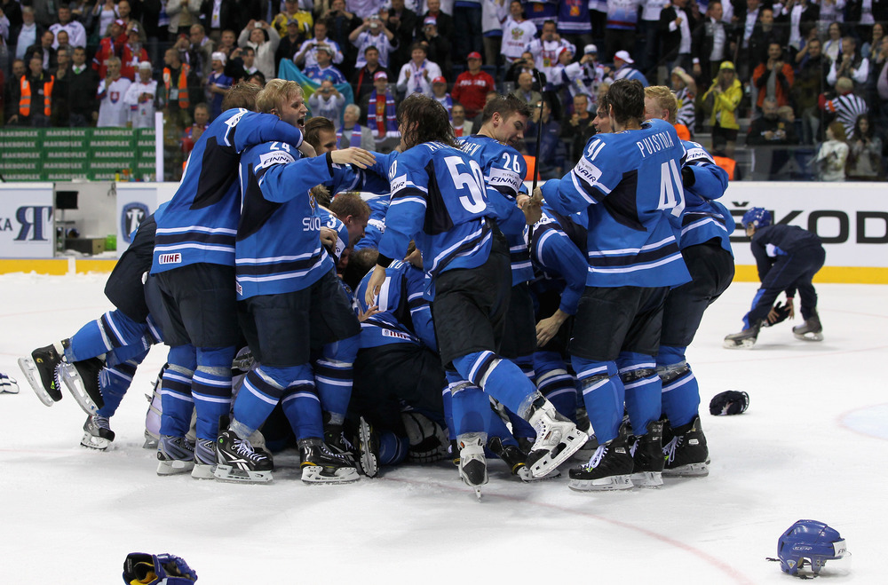 BRATISLAVA, SLOVAKIA - MAY 15:  The team of Finland celebrate after winning the IIHF World Championship gold medal match between Sweden and Finland at Orange Arena on May 15, 2011 in Bratislava, Slovakia.  (Photo by Martin Rose/Bongarts/Getty Images)