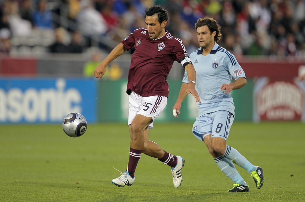 Colorado's  Pablo Mastroeni (left) has been ruled out for tonight's match against Sporting KC and Graham Zusi. (Photo by Doug Pensinger/Getty Images)
