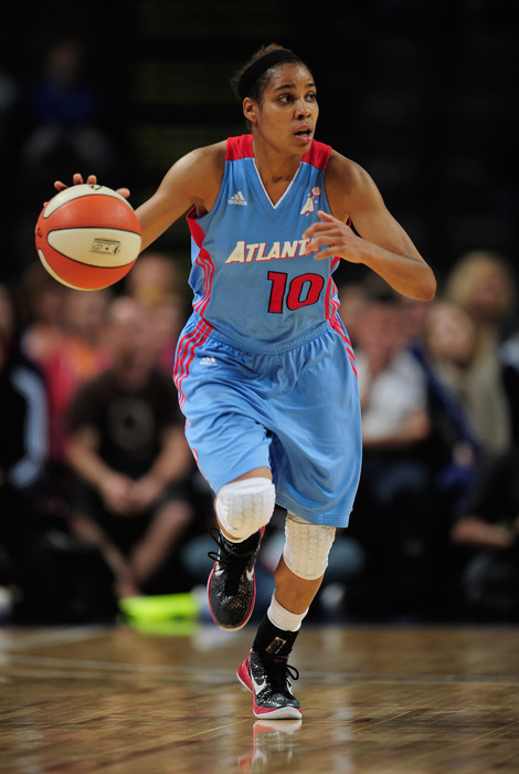 While all the attention goes to forward Angel McCoughtry, Atlanta Dream point guard Lindsey Harding's quietly improving efficiency is no small part of their late-season success. (Photo by Jamie McDonald/Getty Images)