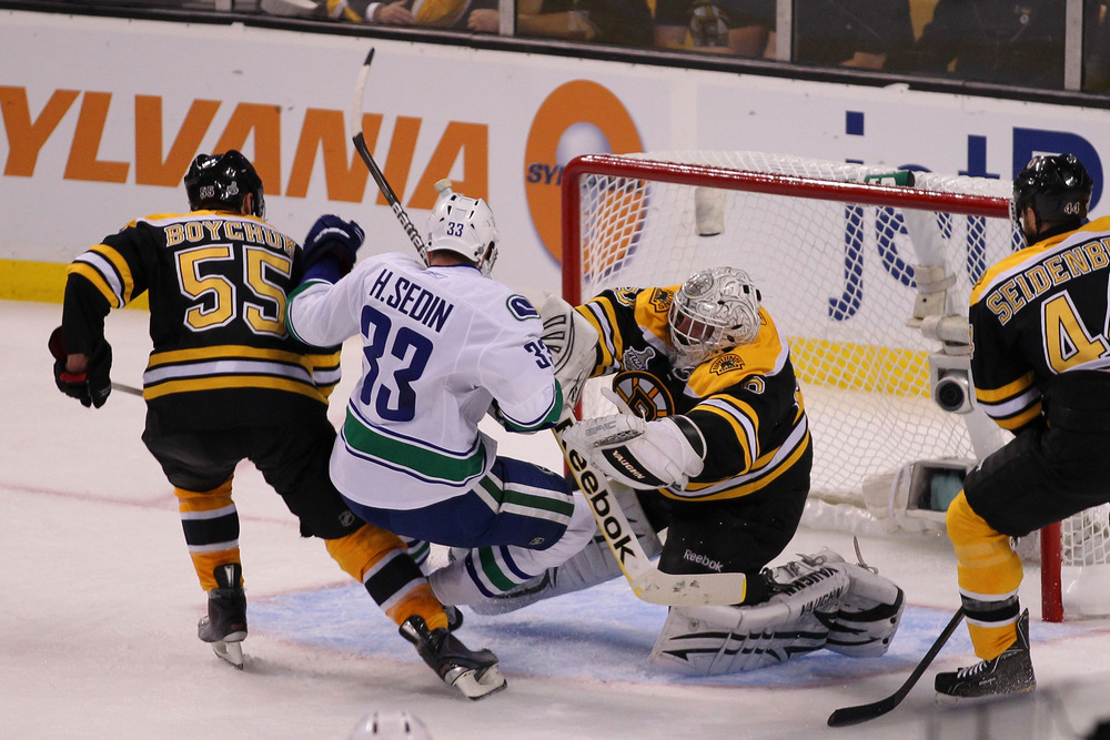 AMERICA! F*CK YA! Tim Thomas gives Twin 1 (or 2?) a piece of American pie in the face.
