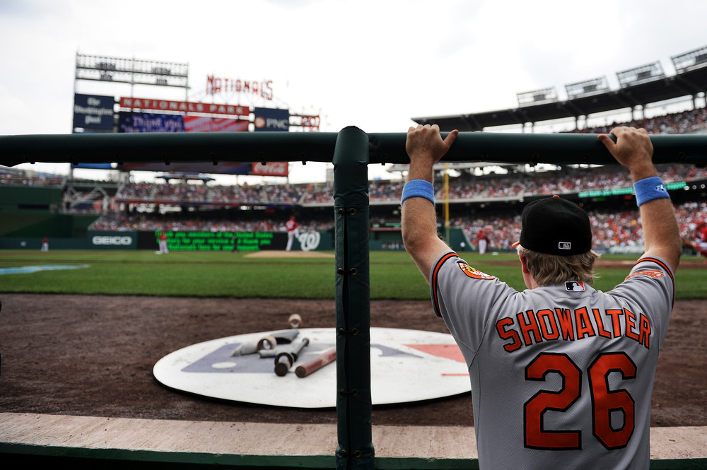 WASHINGTON, DC - JUNE 19: Baltimore Orioles manager in baseball Buck Showalter watches play against the Washington Nationals at Nationals Park on June 19, 2011 in Washington, DC. The Baltimore Orioles won, 7-4. (Photo by Patrick Smith/Getty Images)